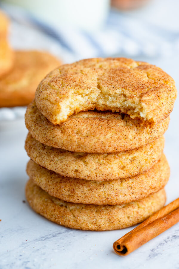 snickerdoodles cookies stacked the top one with a bite out of it