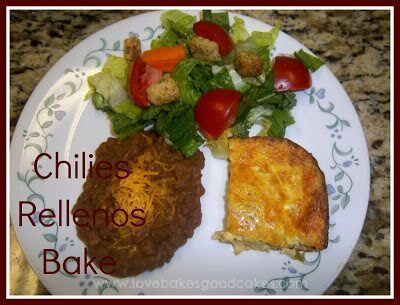 Chilies Rellenos Bake with refried beans and green salad with tomatoes and croutons on white plate