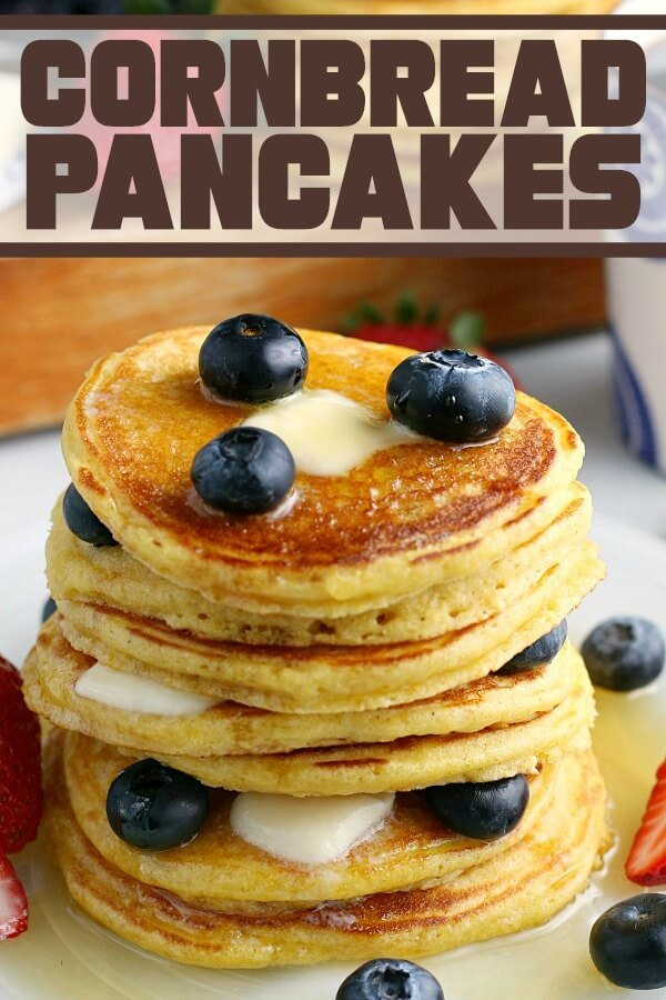 stck of cornbread pancakes with blueberries and maple syrup
