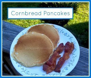 Cornbread Pancakes stacked with bacon on white plate