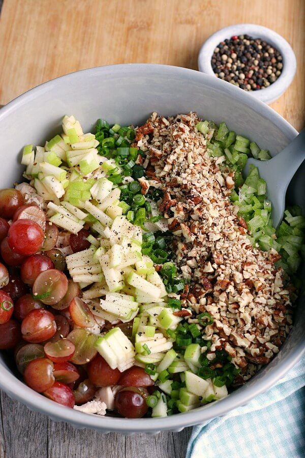 When learning how to make chicken salad it's important to learn the best way to season it! We see more seasonings being added here!
