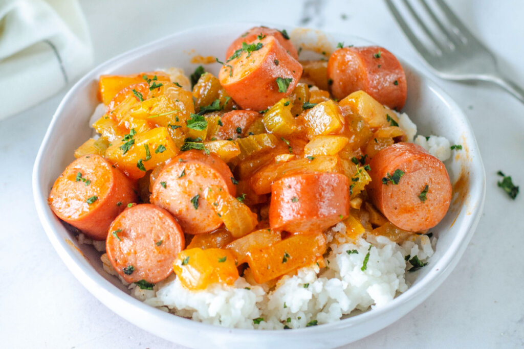 sweet & sour hot dogs over rice in bowl