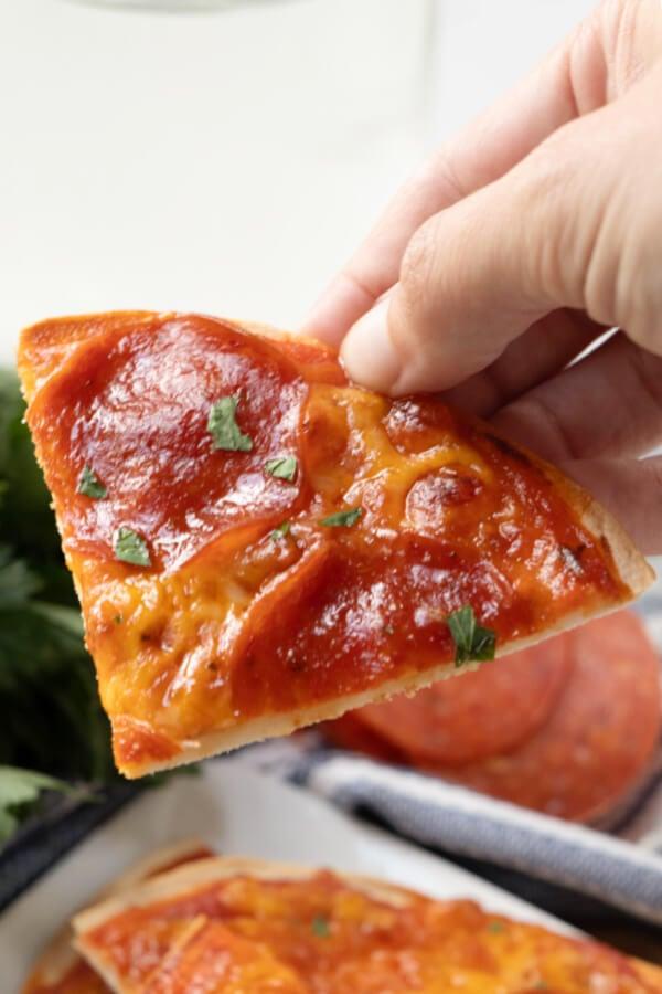 hand holding slice