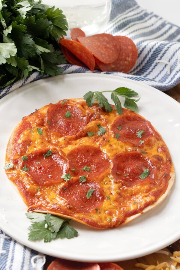 pepperoni tortilla pizza on white plate
