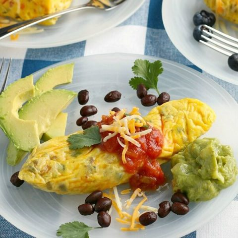 omelet in a bag on plate with garnish