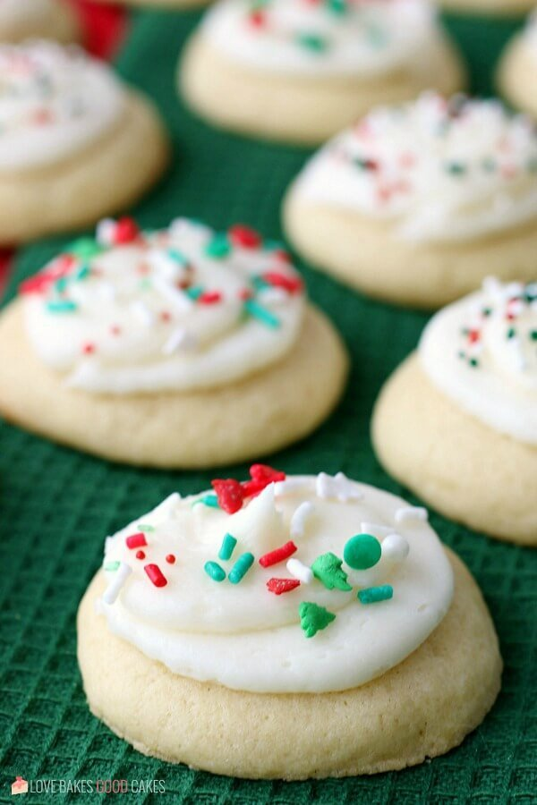 Soft Sugar Cookies with white frosting and red and green sprinkles on top.