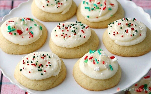 Soft Sugar Cookies laying on a white plate.