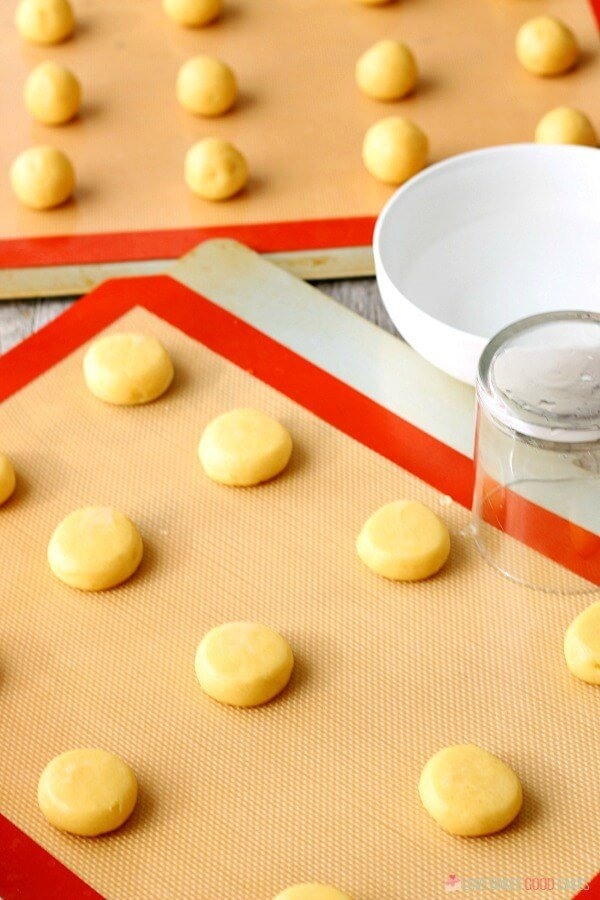 Soft Sugar Cookie dough being put on cookie sheets.