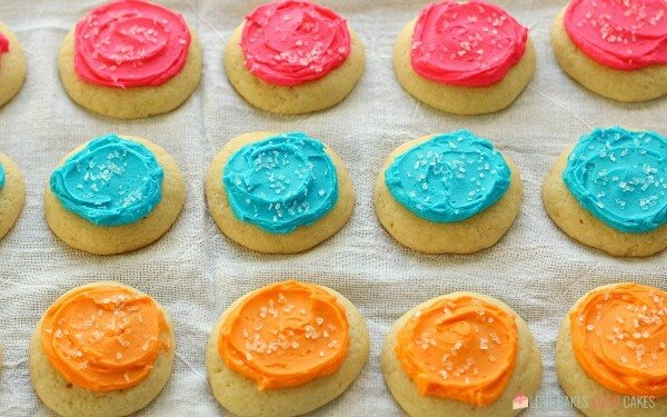 Soft Sugar Cookies laying on a cloth surface.