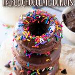 three chocolate donuts stacked