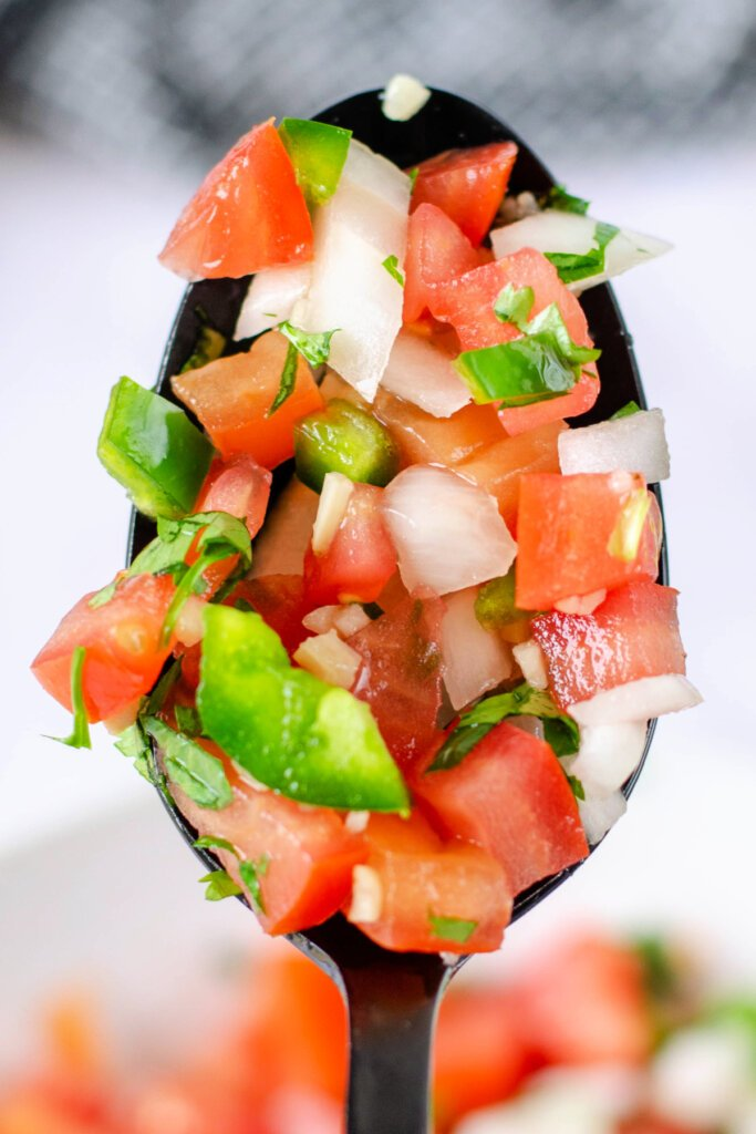 salsa fresca - pico de gallo - on spoon