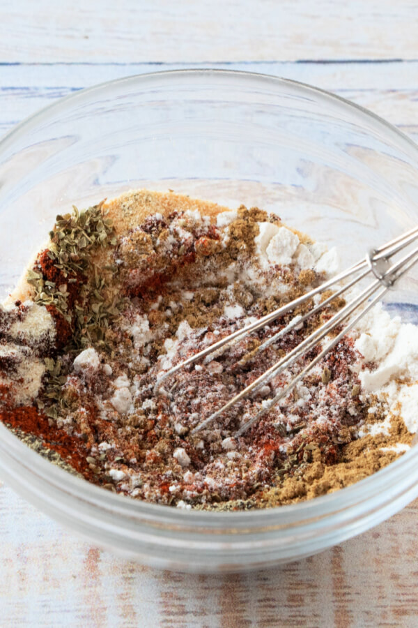 whisking together the spices in a glass bowl