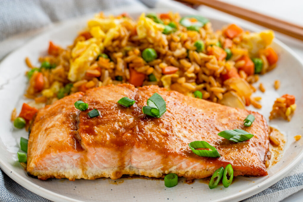 asian salmon with fried rice on plate