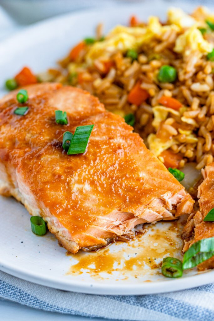 asian baked salmon on plate with fried rice