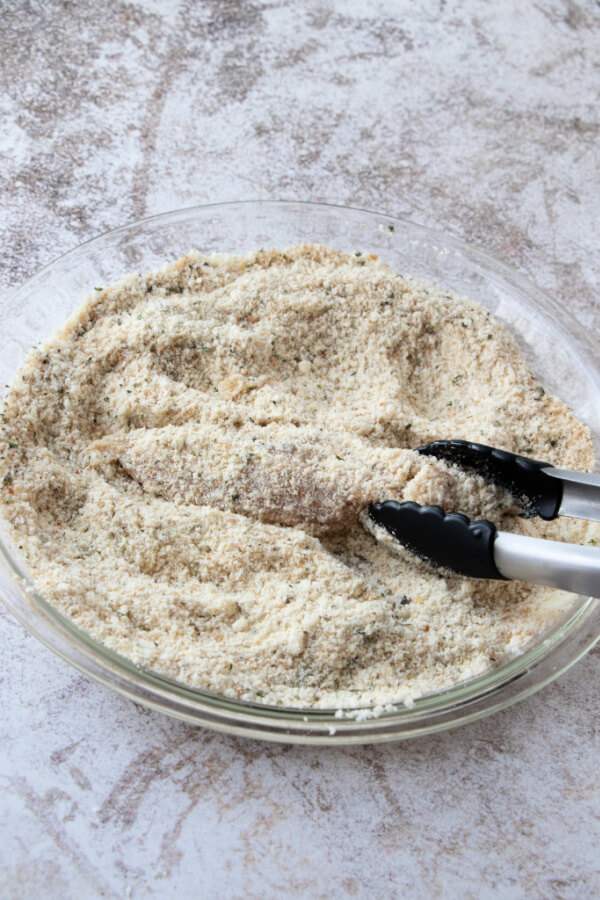 coating the chicken strips in breadcrumb and parmesan mixture