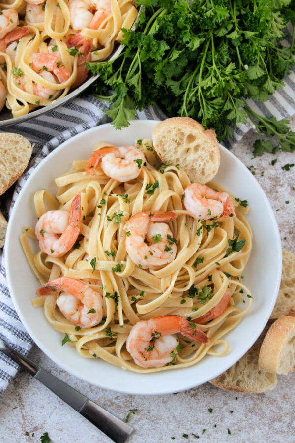 looking down into a bowl of finished shrimp scampi with pasta