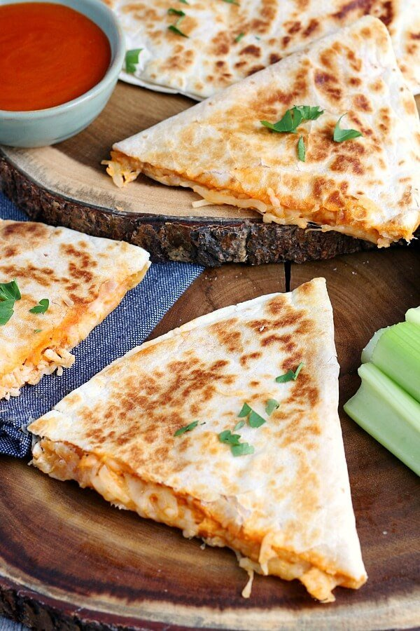 This image shows the finished buffalo chicken quesadillas cut and ready to be served.