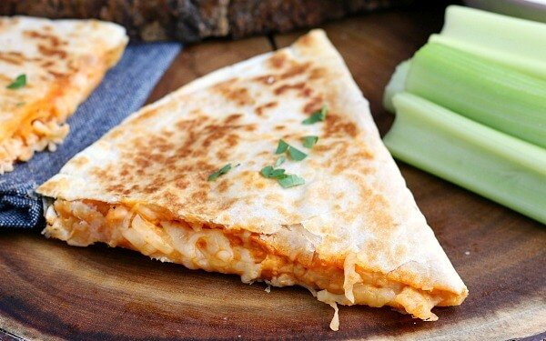 closeup of Buffalo Chicken Quesadilla cut into wedges and ready to be served