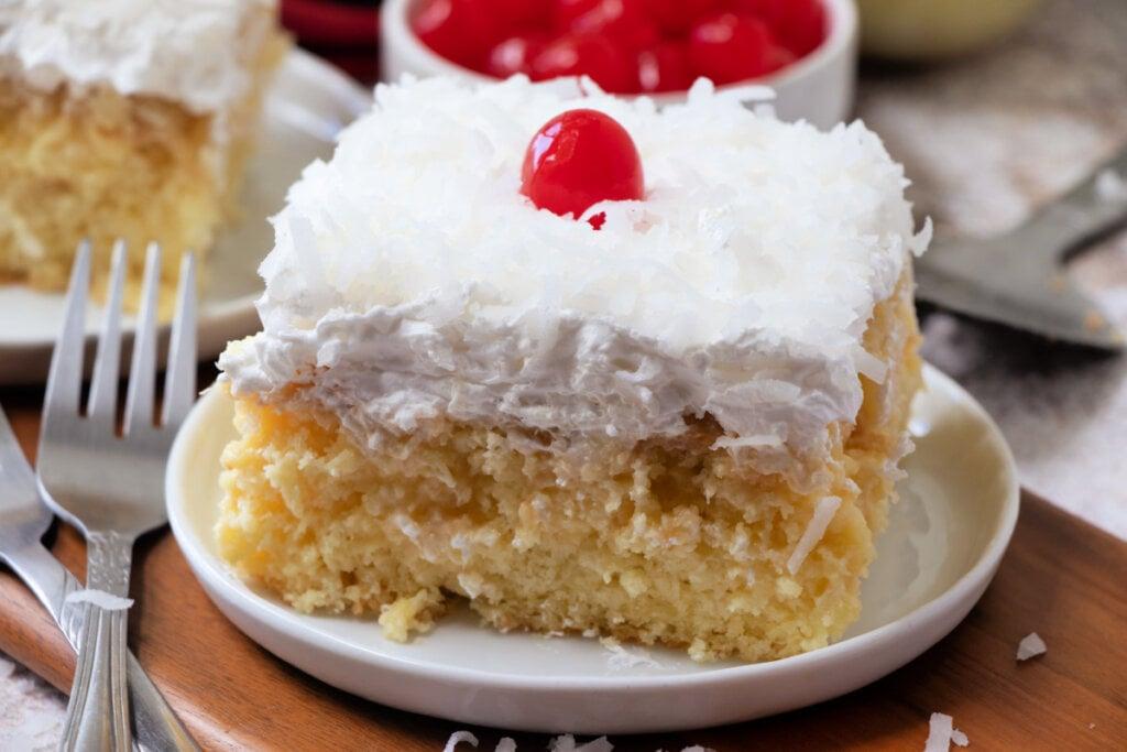 pine colada cake slice on plate