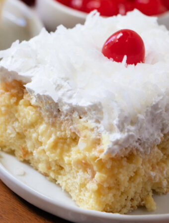 slice of pina colada poke cake