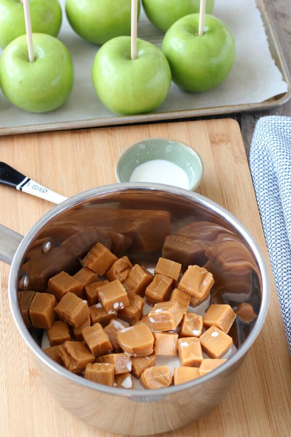 caramels and milk in saucepan