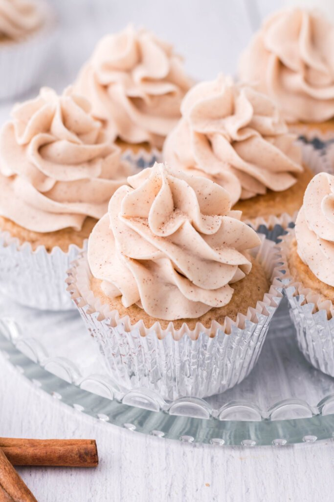 snickerdoodle cupcakes on glass serving plate
