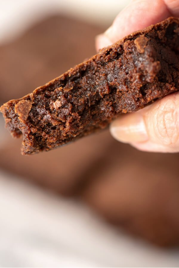 hand holding brownie