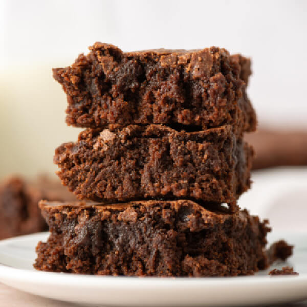 three brownies stacked on a plate