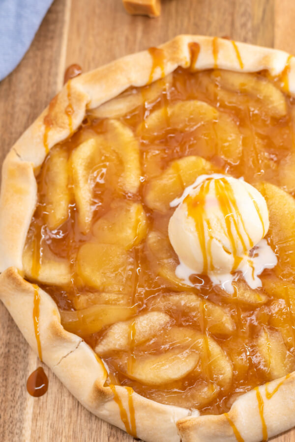 loooking down onto finihsed caramel apple galette with a scoop of ice cream