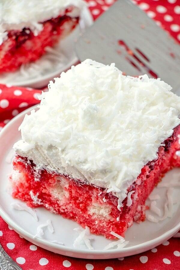 slice of raspberry poke cake on a plate