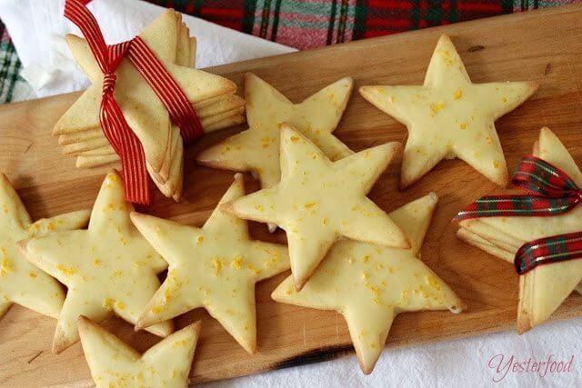 Cornmeal Stars with Orange Glaze stacked up on cutting board.
