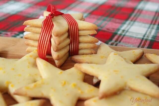 Cornmeal Stars with Orange Glaze close up and wrapped in ribbon.