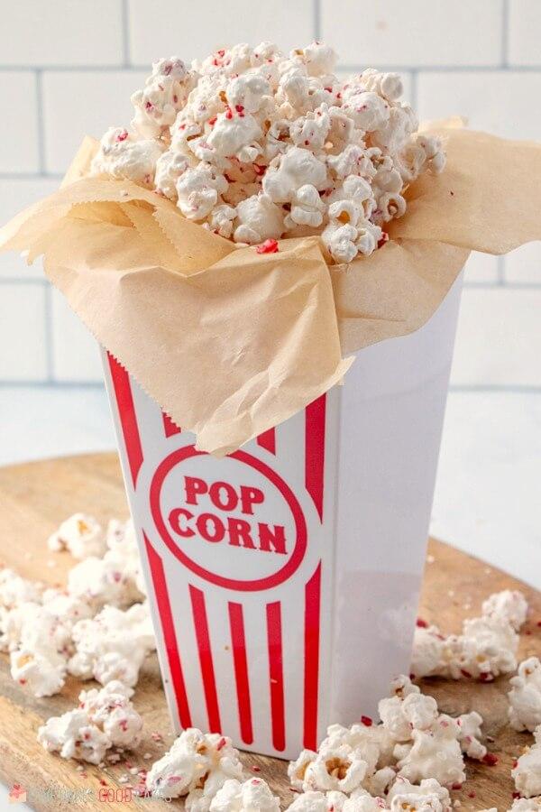 White Chocolate Peppermint Popcorn in a popcorn box