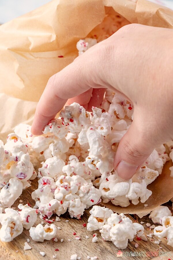 hand picking up popcorn