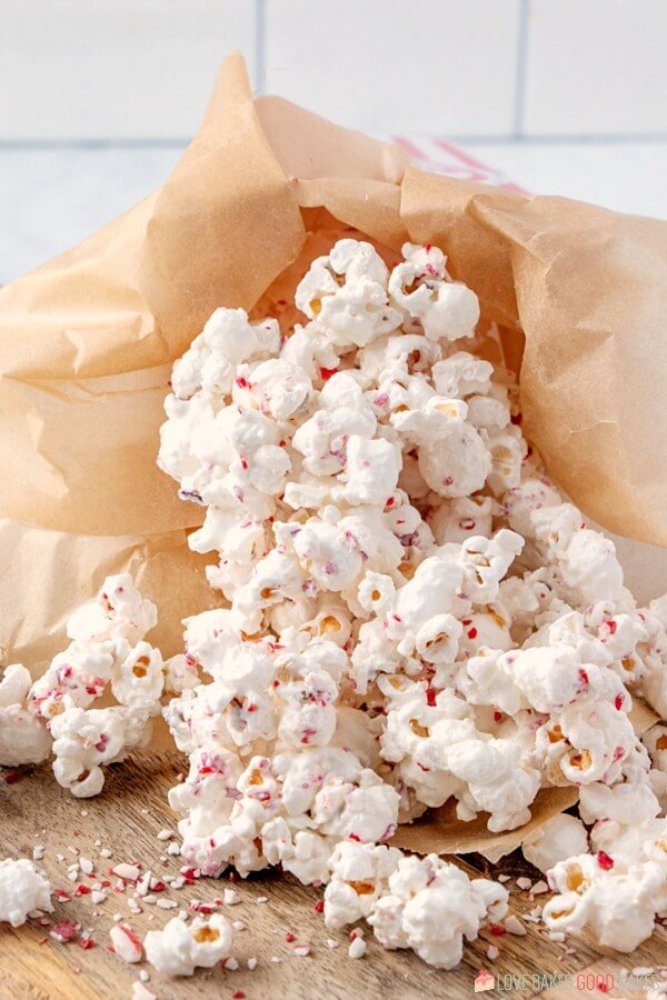 I have the perfect way to use up those candy canes - White Chocolate Peppermint Popcorn! Perfect for gift giving or holiday snacking!
