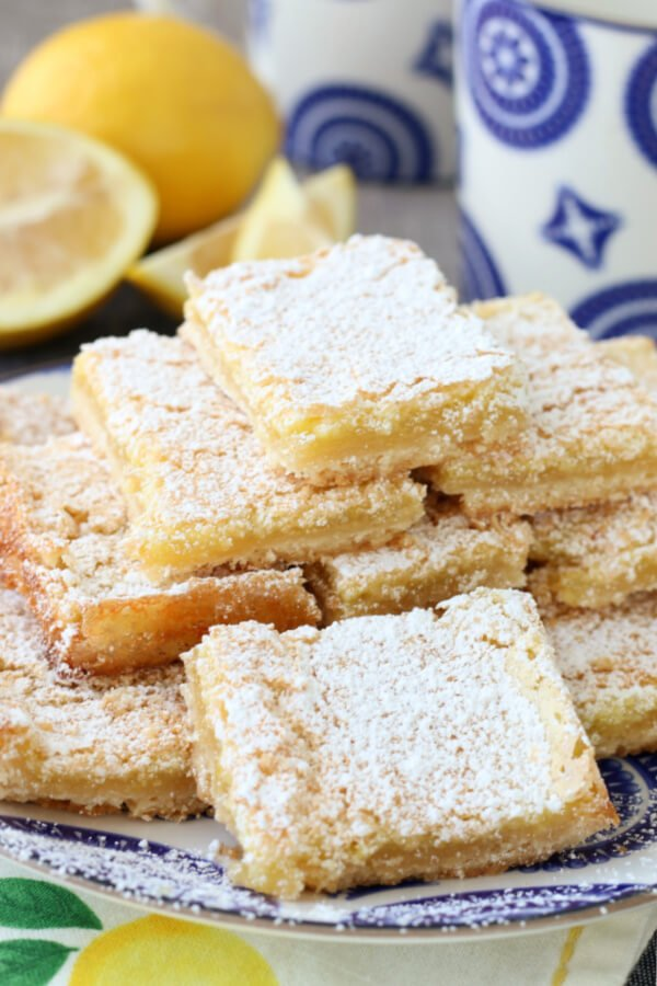 stacked lemon bars on plate