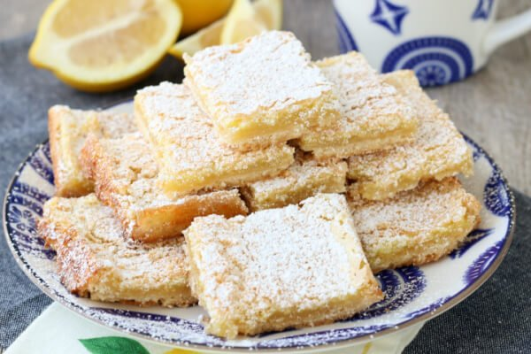 stck of lemon bars on plate