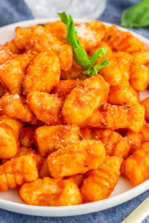 gnocchi coated in red sauce
