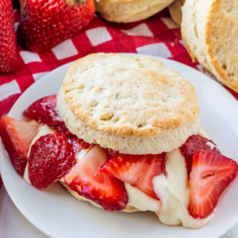 strawberry shortcake with lemon cream sauce on plate
