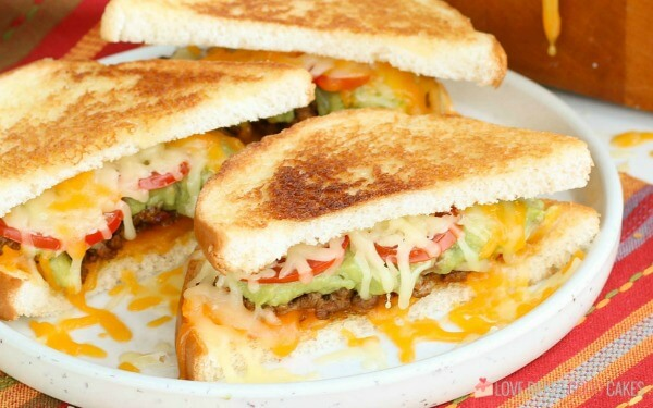 closeup of cut taco grilled cheese sandwich