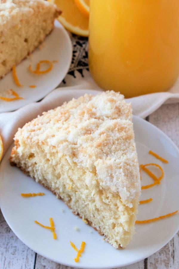 orange streusel coffee cake slice on plate