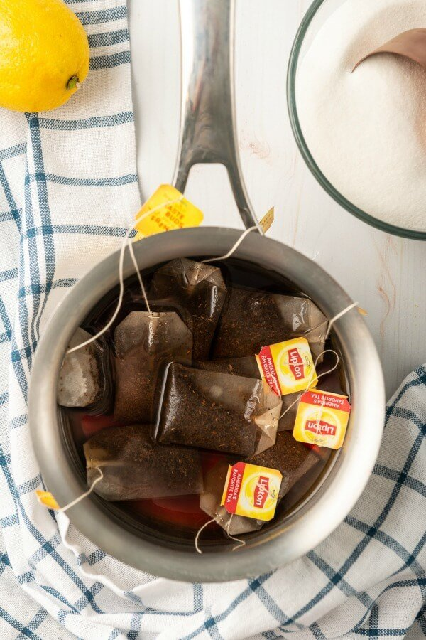 tea bags steeping in a pot of water