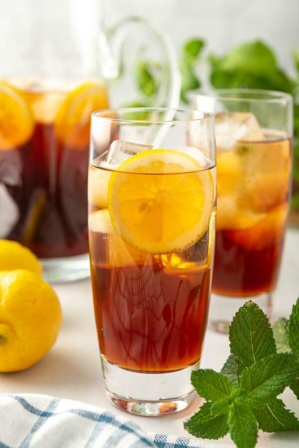 cold glass of sweet iced tea with lemon