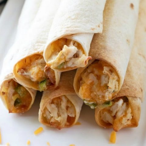 closeup of jalapeno popper chicken taquitos on plate