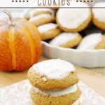 Soft Pumpkin Spice Cookies stacked up on a napkin.