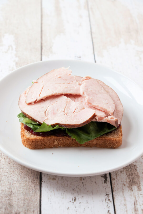adding leftover turkey to sandwich