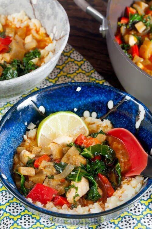 "Red Curry Eggplant and Kale Over Cauliflower ""Rice"" in a bowl."