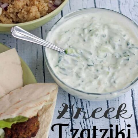 Greek Tzatziki Dip in a bowl with a spoon.