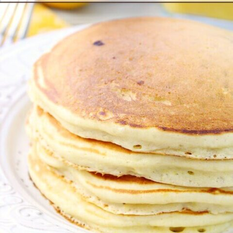 Lemon Berry Pancakes stacked on a plate.