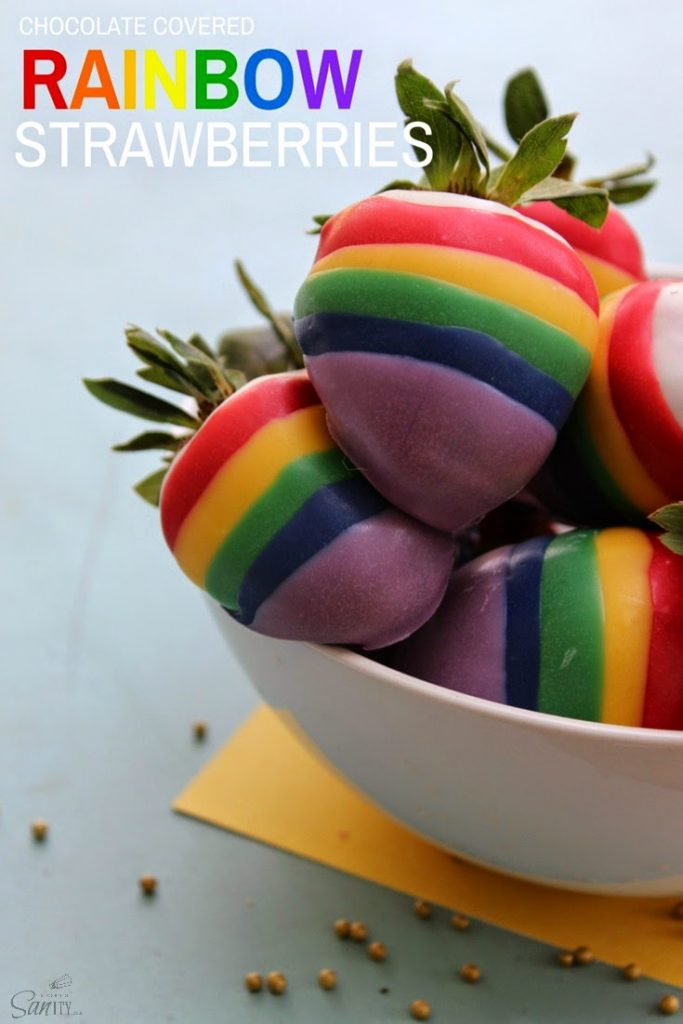 Chocolate Covered Rainbow Strawberries piled in a bowl.